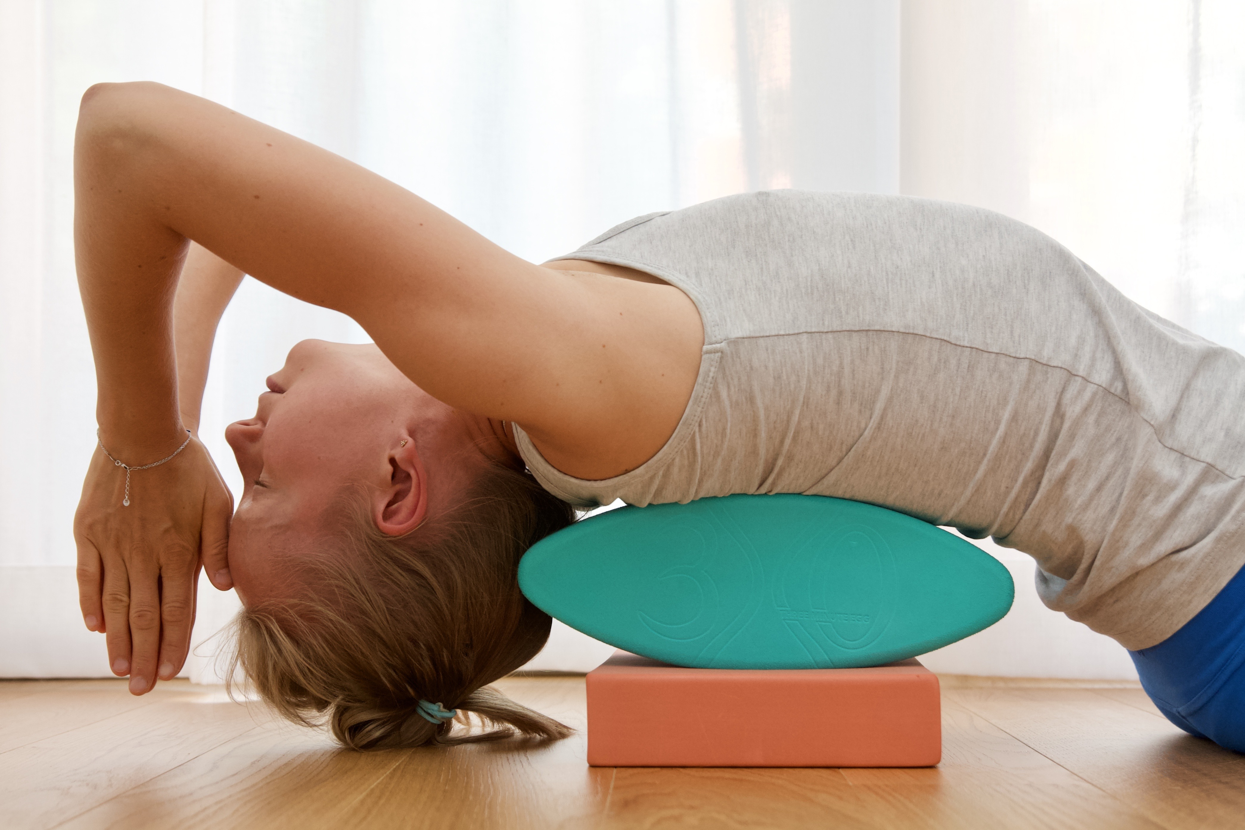Supported backbend with egg yoga props